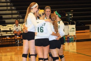 After they score a point, varsity volleyball players huddle up to celebrate. On Sept. 12, Staley played Raytown High School and won the match.