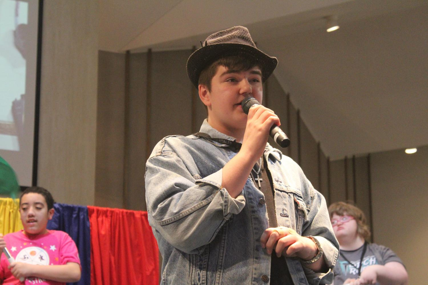At the Ability Arts Festival performance at North Cross United Methodist Church, sophomore Josh Roush sings lead for on March 9. He said he wore a hat during the performances and picked out his outfit himself.