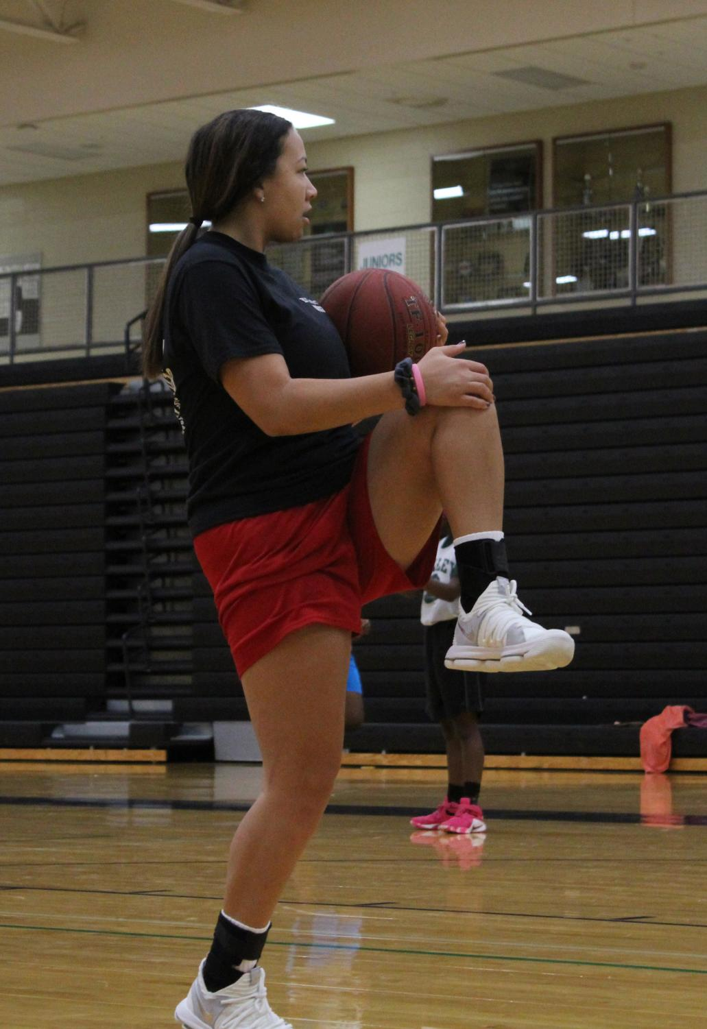 "Warming up for basketball practice Nov. 4, senior Emilyn Richardson is preparing for practice. Joining the team this year, Richardson is eager to get the season started. ""It's going to be a fun and exciting season. Yes, we will have some ups and downs but that's just part of it."""