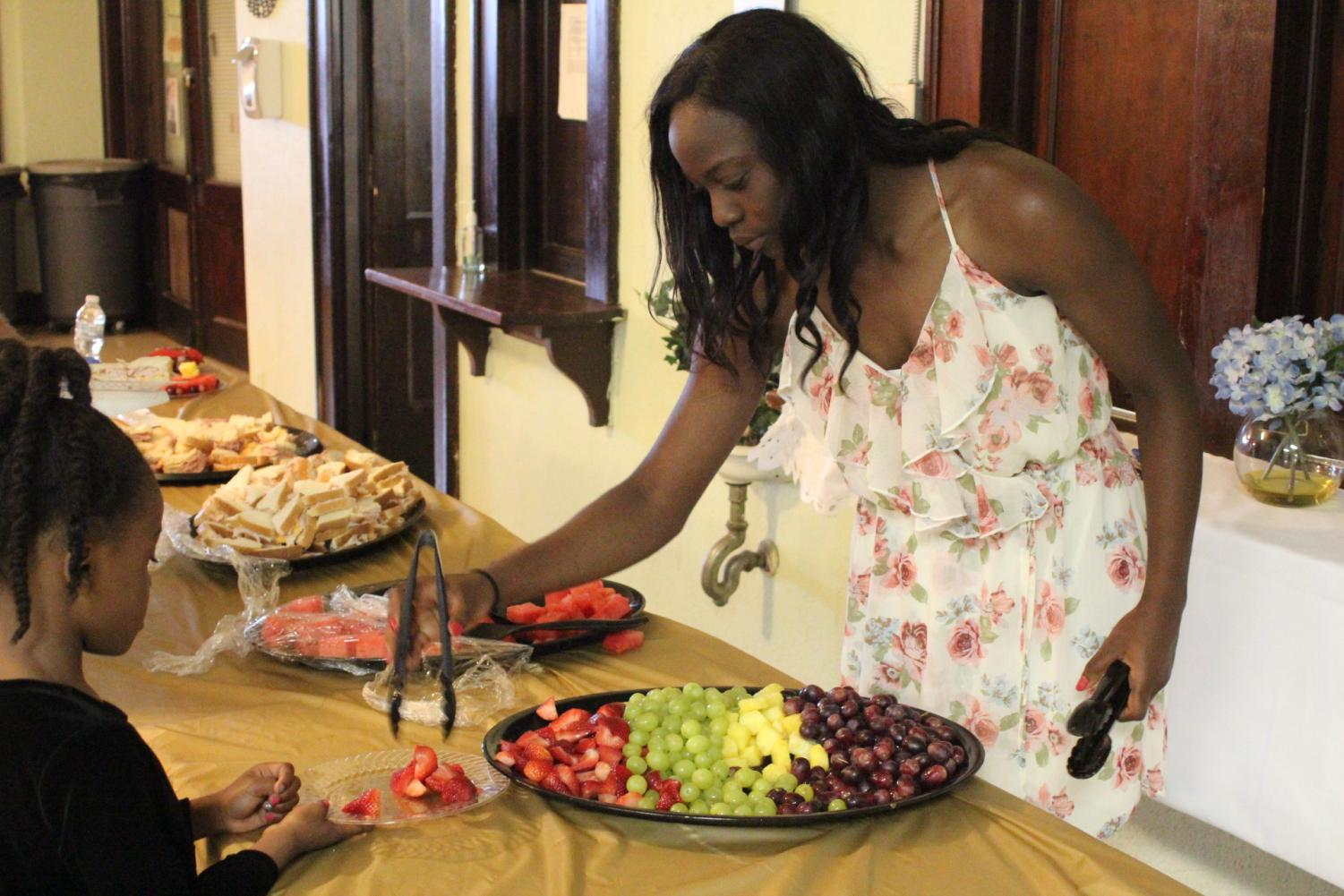 "At the Hope Center's awards ceremony on May 22, sophomore Nia Daniels helps serve food for the kids. The ceremony was to honor and recognize the different program's accomplishments and service. ""Everyone was celebrated and people had a great time,"" said Daniels."