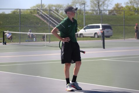 "In his singles match freshman Mason Gates plays against the Winnetonka High School Griffins on May 7 during districts. Mason is the No. 2 on varsity, and the team won the match 5-0, however Mason's match was unfinished due to the team winning. ""The only reason we won is because at the end of the day, we had more grit,"" said Mason Gates."