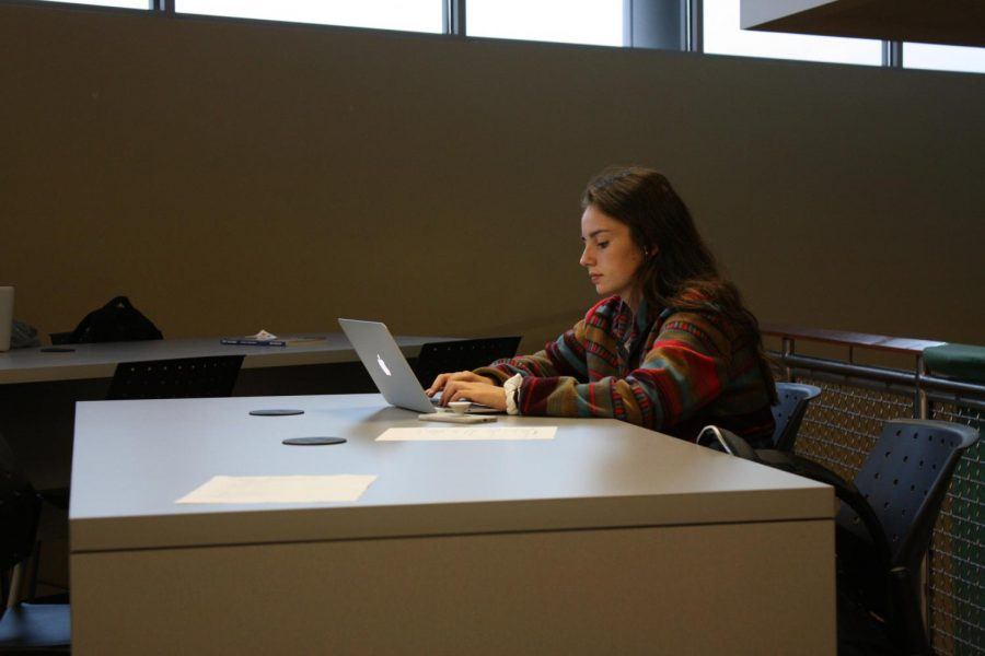 Before school in the Falcon's Nest, senior Brooklyn Hannan works on homework on Sept.18. Hannan often used the space to work on her Exhibition project.