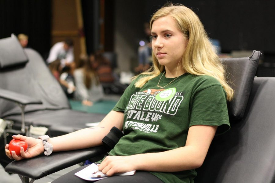 At+the+blood+drive+Oct.3%2C+students+and+staff+donated+blood+to+help+save+lives.+Three+donors%2C+sophomores+Madison+Swafford+and+Grace+Spitzmiller%2C+and+junior+Alyssa+Malena+participated+in+the+first+drive+of+the+school+year+held+by+Student+Council.+There+were+35+pints+of+blood+donated+with+the+help+Red+Cross+staff.+%22I+felt+good+knowing+that+I+could+be+helping+someone+else+just+by+doing+this+little+act%2C%22+said+Swafford.+