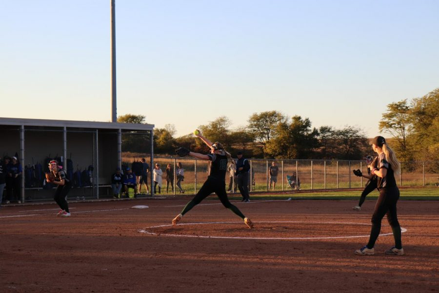 At+the+top+of+the+fifth+inning%2C+senior+Alanna+Vawter+pitches+against+Liberty+High+School+in+the+sectional+game+Oct.+17.+Vawter+was+on+the+team+all+four+years+with+a+personal+record+of+19-4+her+last+season.+%E2%80%9CObviously+there+was+a+lot+on+the+line+this+time.+It%E2%80%99s+one+of+those+games+that+you+kind+of+wish+you+could+take+back+a+couple+pitches+here+or+there%2C+but+that%E2%80%99s+part+of+the+game%2C%E2%80%9D+said+Vawter.