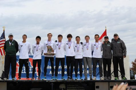 "After winning third place as a team at cross country state Nov. 3, runners juniors Murphy Corum, Nathan Nguyen, senior Preston Wheeler, juniors Luke Winkler, Jack Warner, Collin Riggins, sophomores Dawson Walker and Drew Sallman stand while wearing their new medals. This was the first time since 1983 that a North Kansas City School District school made it to the podium at state. ""It felt great to be up there with all the guys. We had worked all year for that moment and we all did our part to make it possible,"" said Winkler."