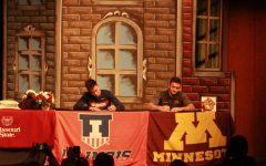 "Highly ranked gymnasts' seniors Victor Perez and Evan Manivong sign their letters of intent on Nov. 14 in the Performing Arts Center. Manivong signed to the University of Illinois and Perez signed to the University of Minnesota. ""I was happy that it was finally signing day. I had been waiting for that moment for a while,"" said Manivong. Photo by Lexi Valdez"