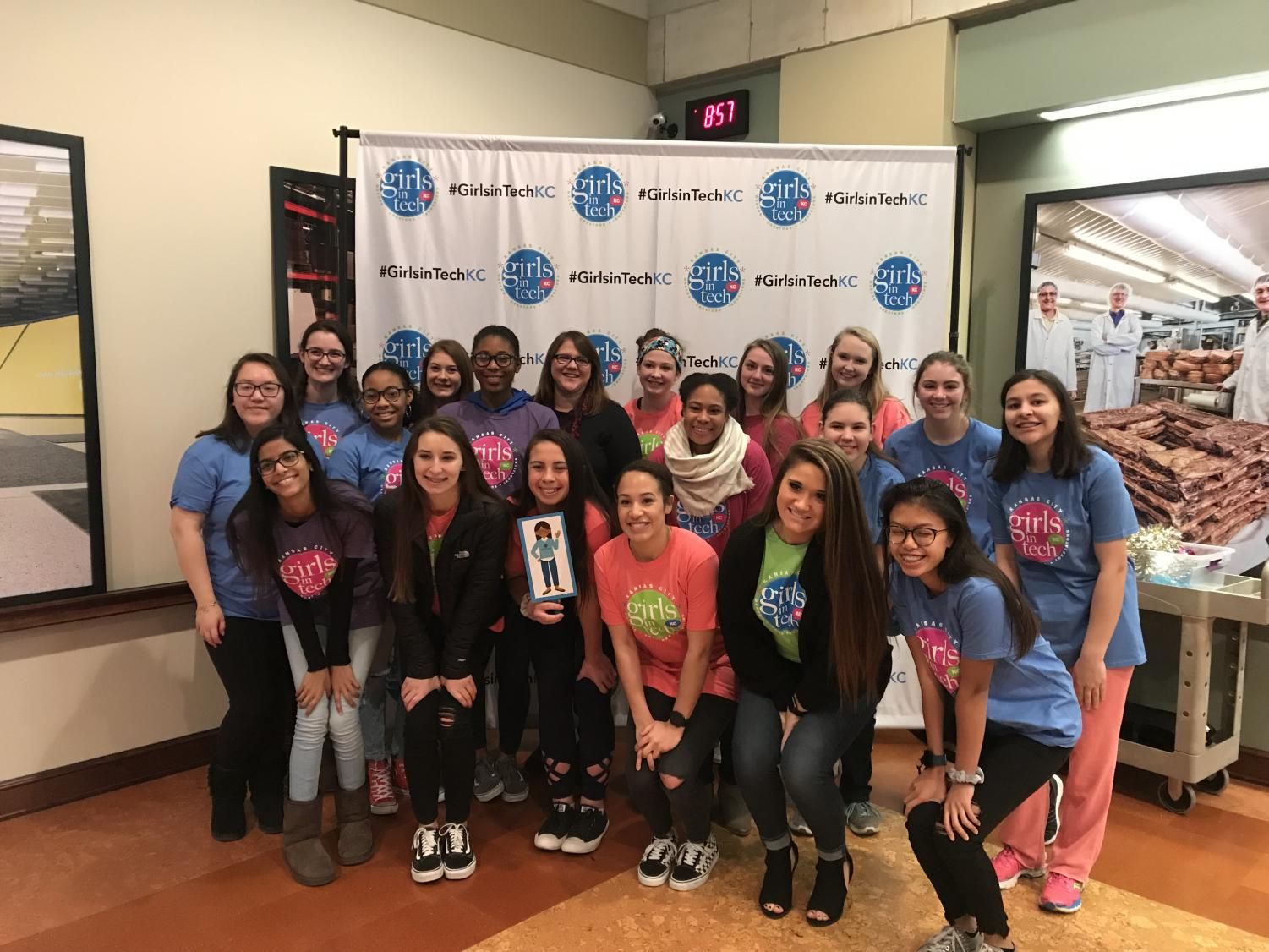 "Girls from Staley pose in front the ""#GirlsInTechKC"" wall wearing T-shirts from the event. ""I'm so glad that we went, it was a great experience,"" says sophomore Sophia Jordan. The eighteen girls, all from different grades, worked alongside each other throughout the day."