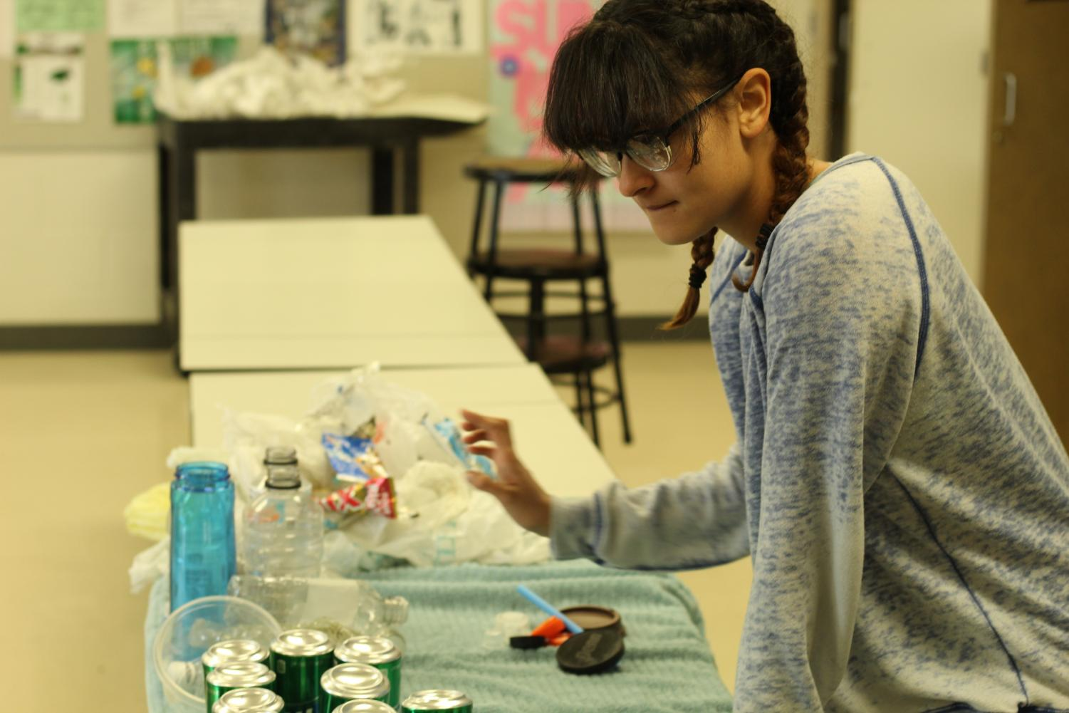 In+art+teacher+Manabu+Takahashi%E2%80%99s+classroom+April+28%2C+freshman+Camilla+Rivera+begins+sorting+the+cleaned+trash+into+categories+for+storage+and+throw+away.+Rivera+preferred+the+sculpture+part+of+the+project.+%E2%80%9CI%E2%80%99m+really+excited+to+build+it+because+cleaning+up+was+a+little+bit+hard%2C%E2%80%9D+said+Rivera.