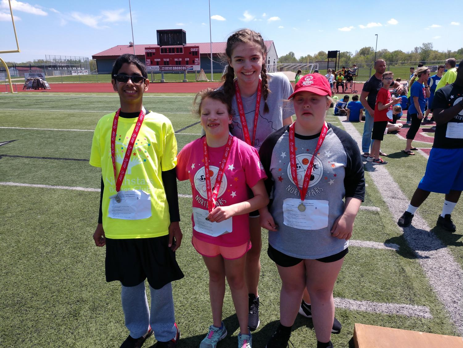 """At this year's Regionals, sophomore Nasi Wright, freshman Casey Dodge, Staley alumni Emily Taylor and Staley Unified Partner Addy Bahn smile with their medals for the Unified 4x1 Relay Raceon Apr. 27 at Lees Summit Highschool. Dodge competed in softball, track and bowling this year. When asked what she felt to win the medal, """"Happy."""" said Dodge."""