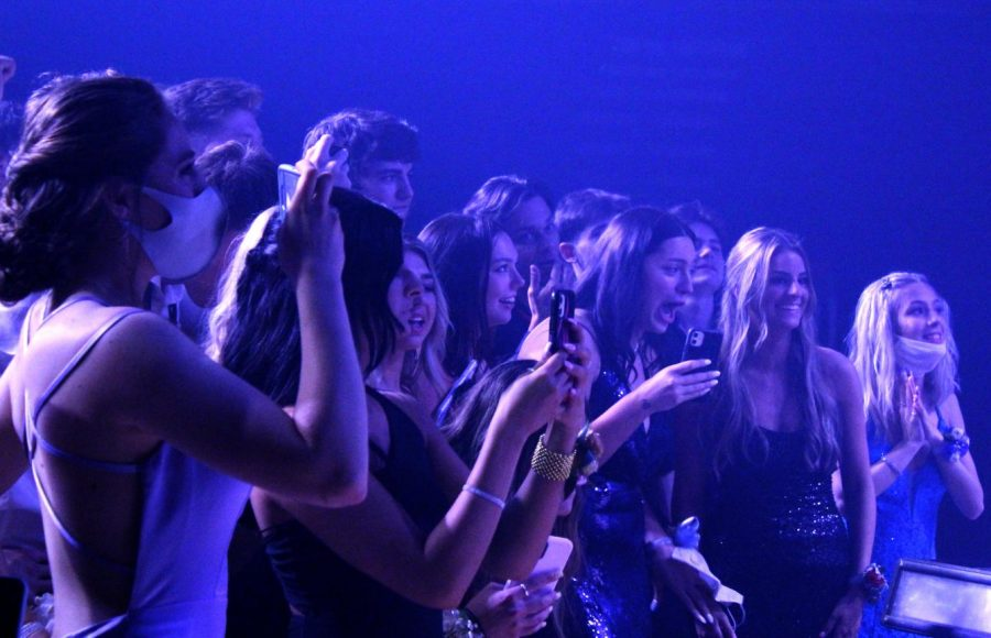 """After missing their junior year Prom, seniors Leah Hayes, Cara Cannova, Luci Saladino, Collin Birch, Emily Cox and Sydney Hadsall wait to see who is annouced Prom king and queen May 1. """"We all came together, and it was a great turn out,"""" said Hayes."""