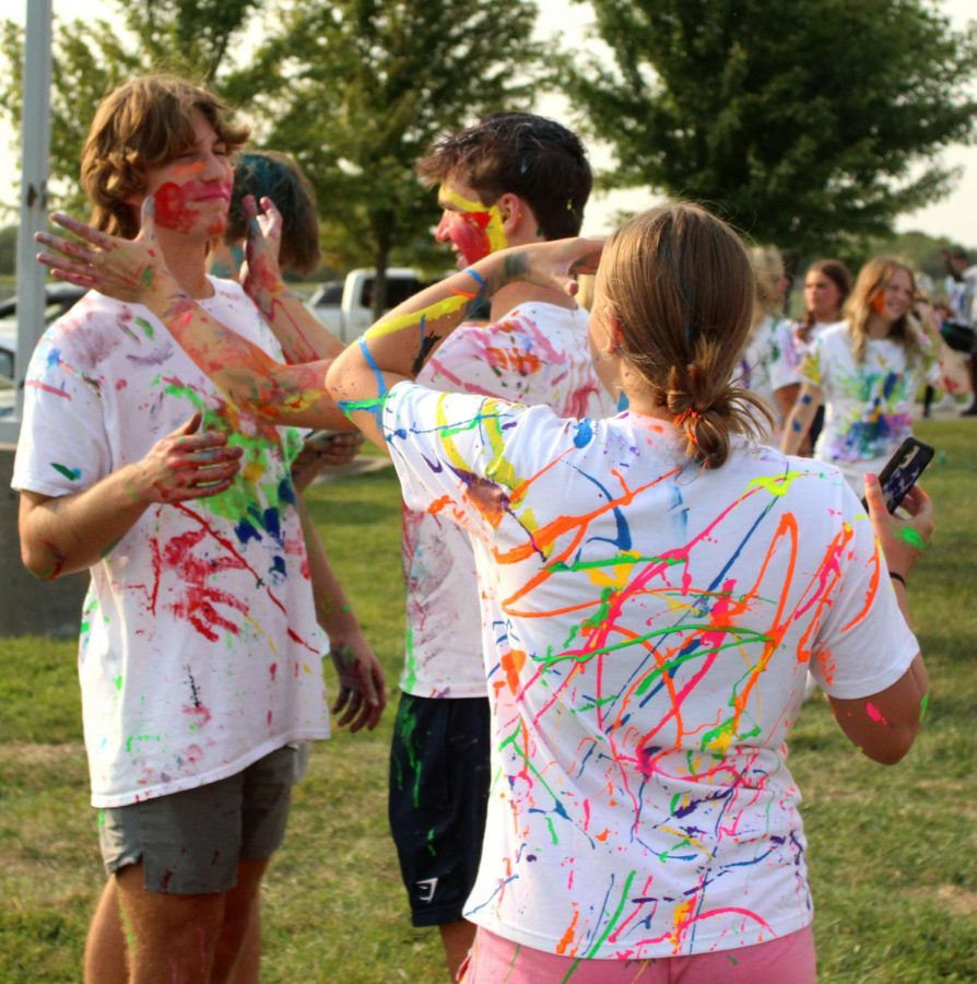 """Taking the paint Sept. 10 at the paint war, sophomores Bryan Richards and Jakob Zahabi participate at The Pavilion. When the painting started, Richards joined in too. """"I was feeling pretty happy because I was with my friends, and I was having a good time,"""" Richards said."""