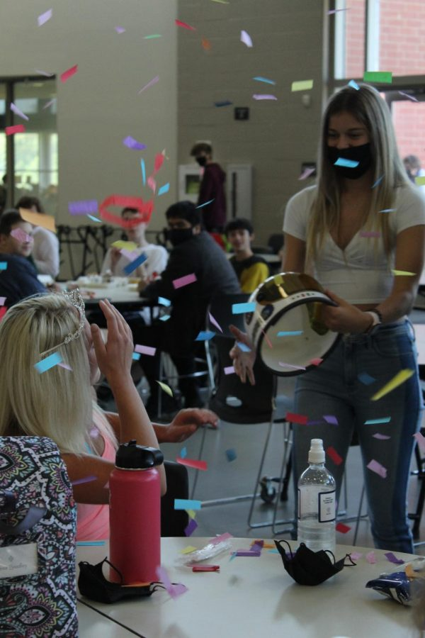 During third lunch, senior Hailey Gifford celebrates the top five homecoming queen announcements.